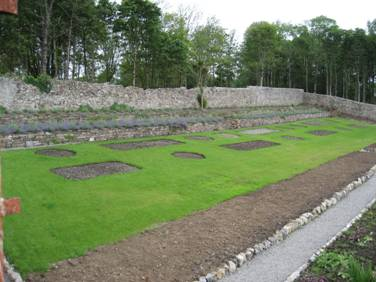 The newly dug out island beds in the lawn, with the lawn border in the foreground