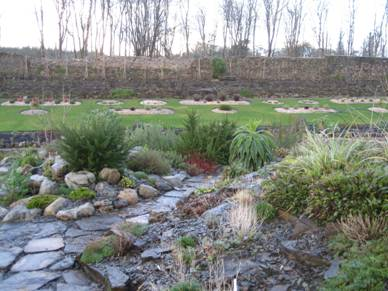 A view from the top rockery over the island beds in the lawn and the revetment beds behind